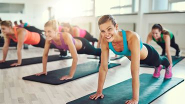 Healthy Women in Push Up Positions on Yoga Mats