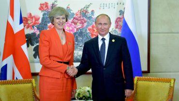 Poignée de main entre Theresa May, Première ministre britannique, et le président russe Vladimir Poutine, au sommet du G20 de Hangzhou, le 4 septembre 2016.