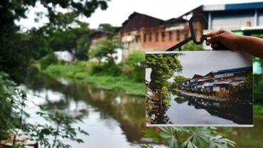 """Des maisons en brique et en bois le long de berges au milieu d'arbres et de potagers ont remplacé ce qui ressemblait naguère à un bidonville, le """"kampung"""" de Tongkol à Jakarta, le 31 janvier 2017"""
