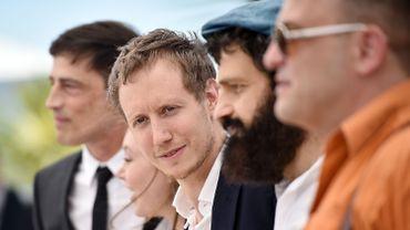 """Le réalisateur Laszlo Nemes (au centre) lors du photocall pour """"Le fils de Saul"""""""