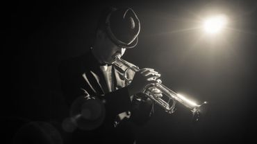 Musician playing the Trumpet with spot light on the stage