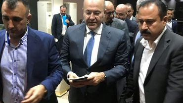 Le nouveau président  d'Irak, le Kurde Barham Saleh (C), élu par le Parlement à Bagdad le 2 octobre 2018