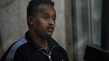 Un homme supposé être l'Erythréen Medhanie Yehdego Mered, accusé d'avoir dirigé un réseau de trafiguants de migrants, au tribunal de Palerme, le 14 février 2019 en Sicile