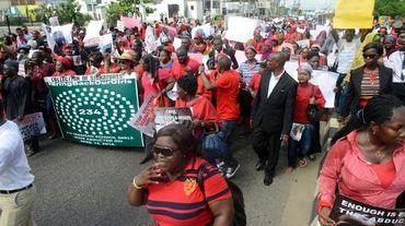Des personnes manifestent à Lagos le 5 mai 2014 pour la libération des 223 lycéeenes enlevées le 14 avril dans leur établissement scolaire de Chibok, au nord-est du Nigeria