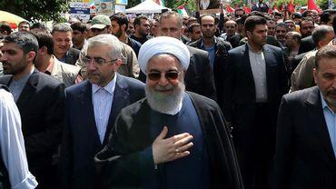 """Une photo fournie par la présidence montre le président iranien Hassan Rohani participer à Téhéran à une marche lors de """"la Journée de Jérusalem"""" en soutien aux Palestiniens, le 31 mai 2019"""