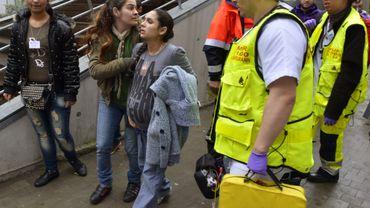 Une ex-occupante du Gesù, enceinte, lors de son arrivée au centre d'urgence mis en palce lundi matin dans le comlexe de sport Liedts