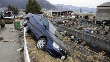 Vue prise le 14 mars 2011 d'une voiture de marque Toyota emportée par le tsunami, à Ofunato, dans la préfecture d'Iwate