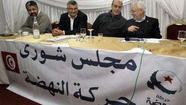 Rachid Ghannouchi (à droite) lors de la désignation du nouveau premier ministre tunisien, jeudi 21 février