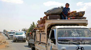 Des civils syriens fuient la province d'Idleb, après des bombardements du régime et de son allié russe le 6 septembre 2018