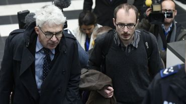 Former employee at services firm PwC Antoine Deltour (R) arrives with his lawyer William Bourdon (L) at the courthouse in Luxembourg on April 26, 2016
