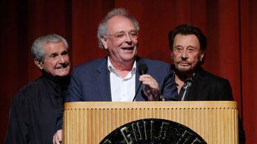 Samuel Hadida, entouré de Claude Lelouch (à gauche) et Johnny Hallyday lors du Colcoa French Film Festival à Los Angeles