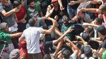 Des Algériens manifestent à Alger le 9 août 2019 contre le pouvoir pour le 25e vendredi consécutif