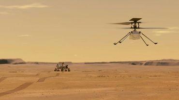 Une illustration, distribuée par la Nasa le 24 mars 2021, montrant le vol prévu de l'hélicoptère Ingenuity au-dessus de la planète Mars