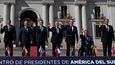 (g-d) Les présidents du Paraguay Mario Abdo Benitez, de Colombie Ivan Duque, d'Argentine Mauricio Macri, du Chili Sebastian Pinera, du Brésil Jair Bolsonaro, de l'Equateur Lenin Moreno et du Pérou Martin Vizcarra, le 22 mars 2019 à Santiago du Chili pour le lancement de la nouvelle organisation régionale Prosur