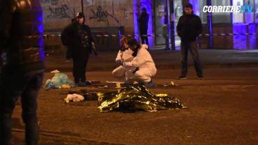 Le tireur inanimé sur le sol, sur la place à proximité de la gare de Sesto San Giovanni.