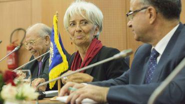 La patronne du FMI, Christine Lagarde, avec le gouverneur de la Banque centrale tunisienne Chedly Ayari et le ministre des Finances Slim Chaker
