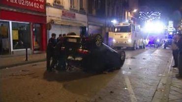 Les forces de l'ordre n'ont pu empêcher certains casseurs de profiter de l'occasion pour se livrer à des actes de vandalisme.