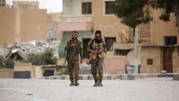 Des soldats des Forces démocratiques syriennes, à Tabqa, le 18 mai 2017