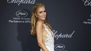 """Paris Hilton à son arrivée à la soirée Chopard """"Wild"""" lors du 69ème festival de Cannes, le 16 mai 2016"""