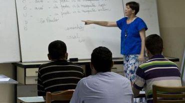 Des réfugiés syriens apprennent le portugais à la mosquée Do Pari dans le centre de Sao Paulo, le 4 mars 2015