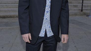 John McEnroe rend visite à des enfants malades