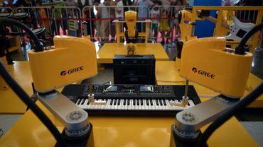 Un robot capable de jouer du piano, présenté au 4e congrès mondial des robots à Pékin, le 15 août 2018