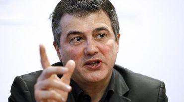 Patrick Pelloux, président de l'AMUF, lors d'une conférence de presse le 23 décembre 2014 à Paris