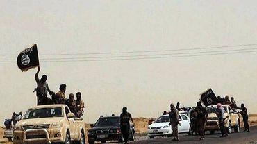 """Les jihadistes de l'Etat islamique se sont emparés de nombreuses villes en Irak et en Syrie, où leur leader Abu Bakr Al-Baghdadi a annoncé l'instauration d'un """"califat"""""""