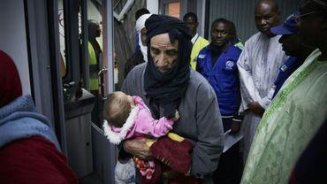 Des migrants maliens rapatriés de Libye par l'OIM arrivent à Bamako le 13 décembre 2017