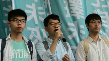 Les militants pro-démocratie Joshua Wong, Nathan Law et Alex Chow arrivent au tribunal de Hong Kong le 21 juillet 2016