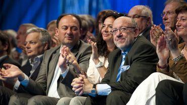 Willy Borsus, ici à gauche sur l'image, n'a cairement pas apprécié le discours de Paul Magnette - 1er mai MR: les classes moyennes célébrées, Paul Magnette dénoncé