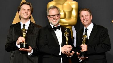 Byron Howard, Rich Moore et le producteur Clark Spencer,