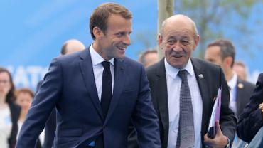 Jean-Yves Le Drian, le ministre français des Affaires étrangères, et Emmanuel Macron, président de la République française.
