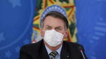 Le président brésilien Jair Bolsonaro tient une conférence de presse, le 18 mars 2020 au palais présidentiel à Brasilia