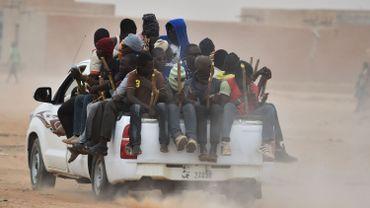 Une camionnette transporte des migrants vers la Libye, près d'Agadez - Juin 2015