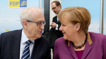 Allemagne: Merkel officialise sa volonté de gouverner avec les libéraux et les Verts