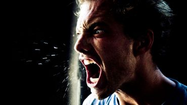 Angry Young Man Yelling and Spitting