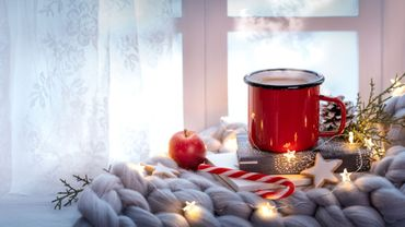Merry Christmas and happy holidays Window with a cup of hot drink