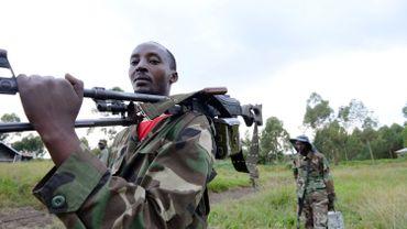 Militiens du M23 en patrouille sur la ligne de front de Mutaho le 3 juin dernier.