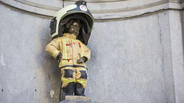 Manneken-Pis a revêtu sa tenue de pompier en hommage aux victimes du 22 mars
