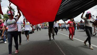 """Des partisans du président Ortega manifestent à l'appel du gouvernement pour demander """"justice pour les victimes du terrorisme"""", le 4 août 2018 à Managua, au Nicaragua"""