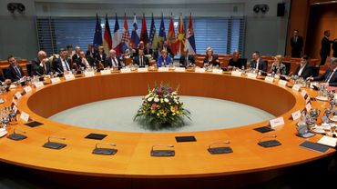The participants in the West Balkans conference including German Chancellor Angela Merkel and French President Emmanuel Macron take their seats at the chancellery in Berlin on April 29, 2019.