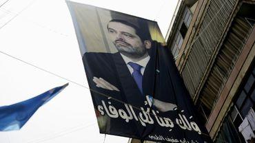 Un portrait du Premier ministre libanais Saad Hariri entre deux bâtiments dans le quartier sunnite de Tariq al-Jadida à Beyrouth, le 4 mai 2018