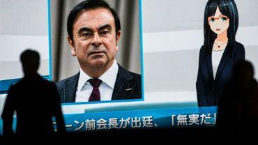 Projection d'un écran de télévision avec la photographie de Carlos Ghosn, dans les rues de Tokyo le 8 janvier 2019