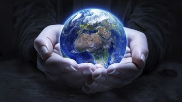 Europe and Africa in hands - Elements furnished by NASA - Stock Image