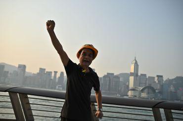Activiste Hongkongais protestant contre les commémorations du régime communisme, à Hong-Kong, le 1er octobre.