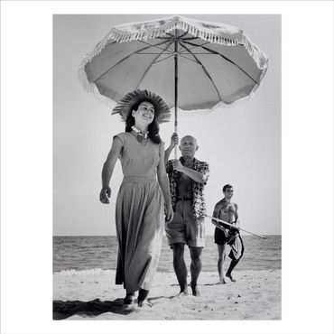 Pablo Picasso with his nephew Javier Vilato and Françoise Gilot on the beach. Golfe-Juan, France. August, 1948.