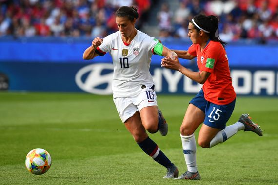 United States' forward Carli Lloyd (L) vies with Chile's defender Su Helen Galaz during the France 2019 Women's World Cup Group F football match between USA and Chile, on June 16, 2019.