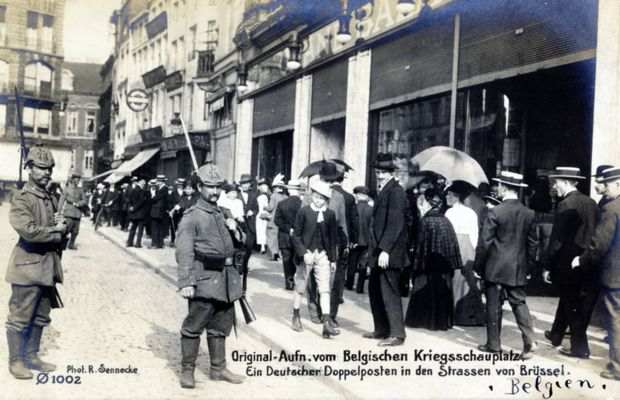 """Original photograph of the Belgian theatre of operations. Two-man patrol in the streets of Brussels"": The helmets worn by these two soldiers serve to identify them as infantrymen from a unit from Hanover, the Füsilier-Regiment Feldmarschall Prinz Albrecht von Preußen Nr.73. This photograph was clearly taken in the summer of 1914, while the occupation was quite recent and the presence of German troops was still fascinating to the curious onlookers wearing their summer straw hats.  - Private collection, Nicolas Mignon. ©"