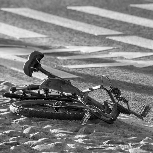 Crushed bike on the ground